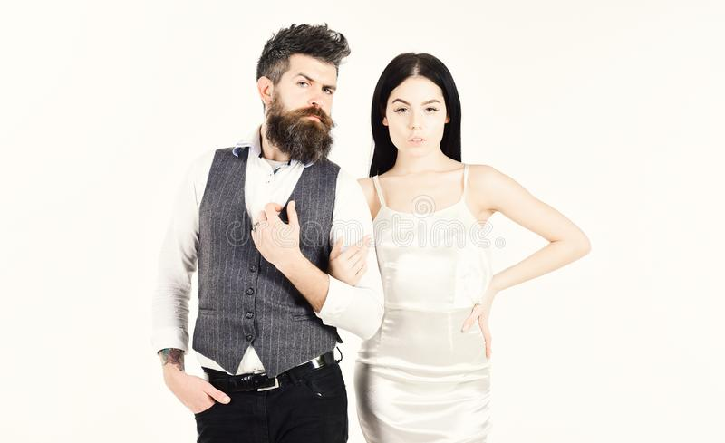 Bearded hipster with bride dressed up for wedding ceremony. Woman in wedding dress and man in vest. Couple in love. Bearded hipster with bride dressed up for stock images