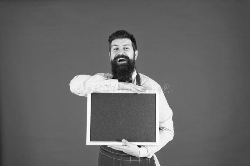 Bearded hipster cook in apron. menu board in cafe. welcome. Restaurant or cafe advertising. great cuisine. cooking by stock images