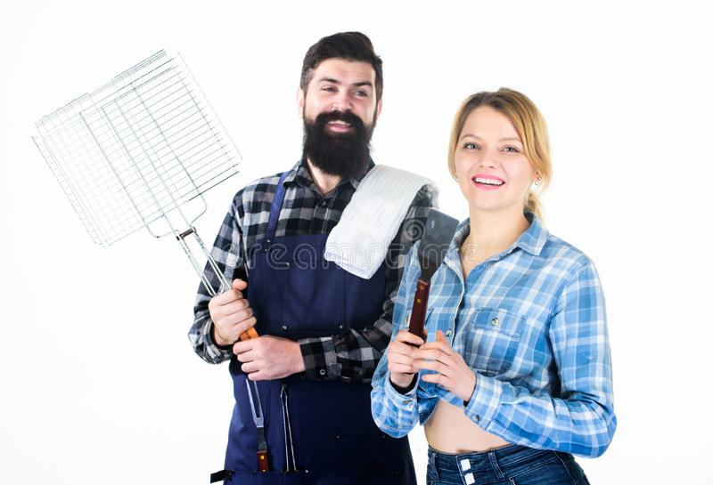 Bearded hipster and girl hold cooking grilling utensils white background. Picnic and barbecue. Family getting ready royalty free stock photo