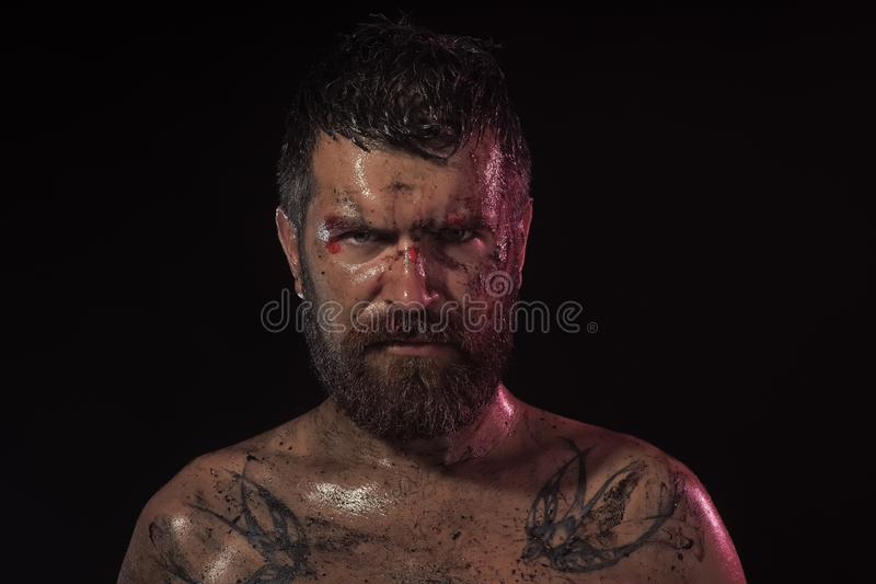 Bearded hipster with tattoo on chest on black background stock photo