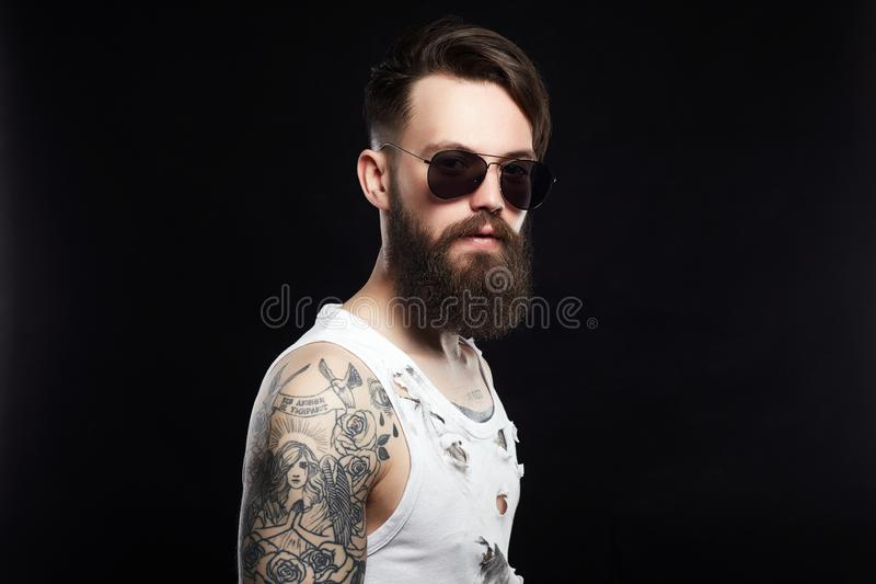 Bearded hipster in vintage torn dirty shirt royalty free stock photos