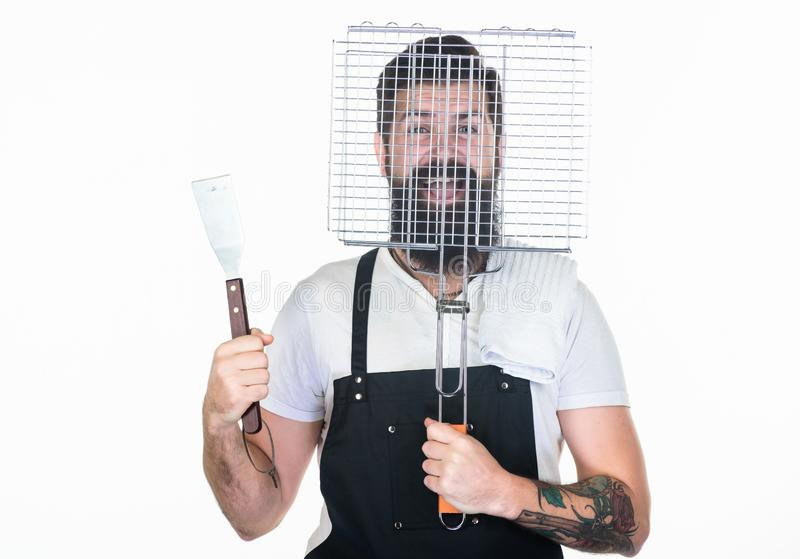 Bearded hipster wear apron for barbecue. Tips cooking meat. Tools for roasting meat outdoors. How choose meat for steak stock photos