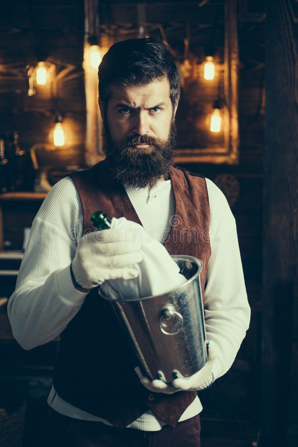 Bearded hipster wear waistcoat.Brutal bearded servant. Hipster barman in waistcoat and gloves. Barman. Waiter is wearing stock photography