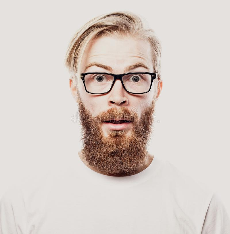 Bearded hipster young man wearing glasses isolated on white background stock photo