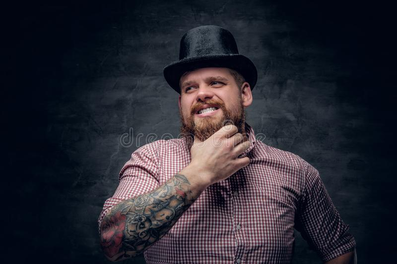Bearded male with tattooed arms stock photos