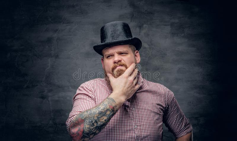 Bearded male with tattooed arms royalty free stock images