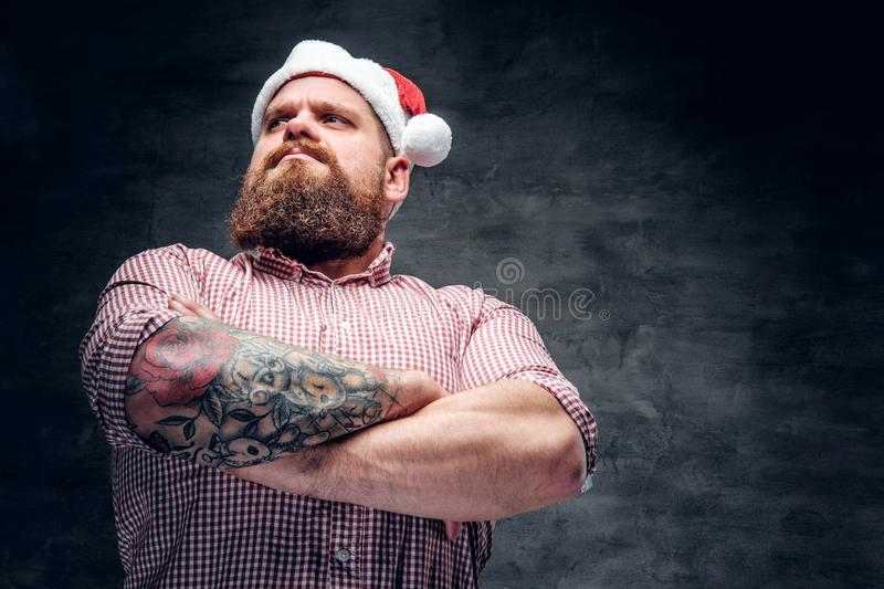 Bearded male wearing Santa`s New Year hat. stock photography