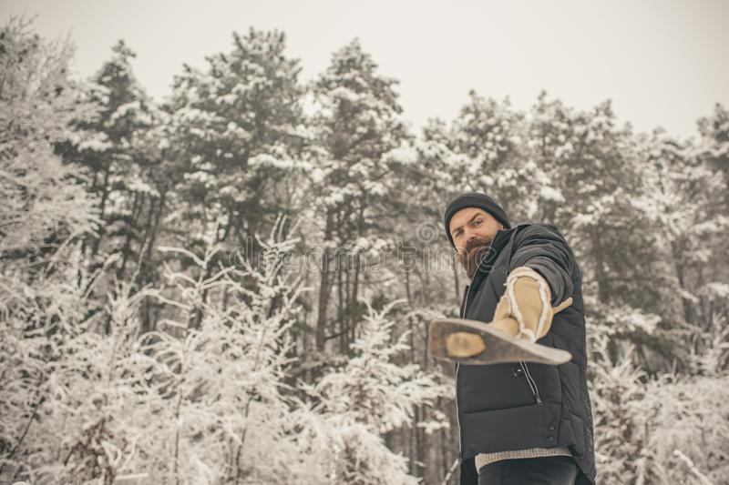 Bearded man with axe in snowy forest. stock photography