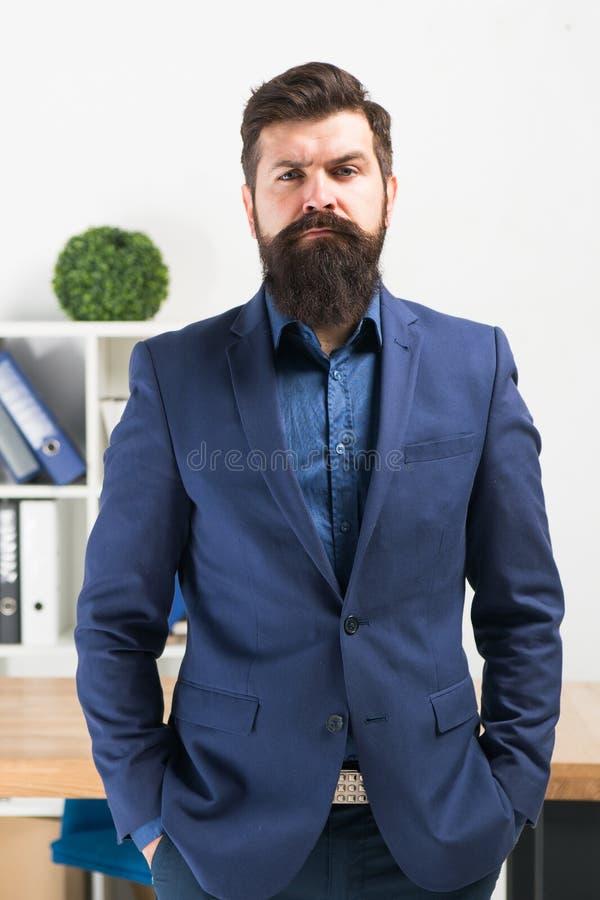 Bearded man boss. Mature hipster with beard. Confident brutal man boss. Business. Modern businessman. Businessman in royalty free stock photo