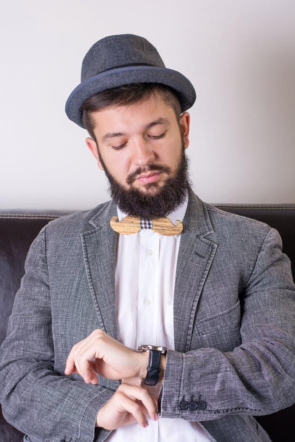 Bearded man with a bow tie stock photos