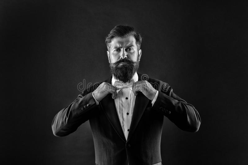 Bearded man with bow tie. Well dressed and scrupulously neat. Hipster formal suit tuxedo. Difference between vintage and royalty free stock photography