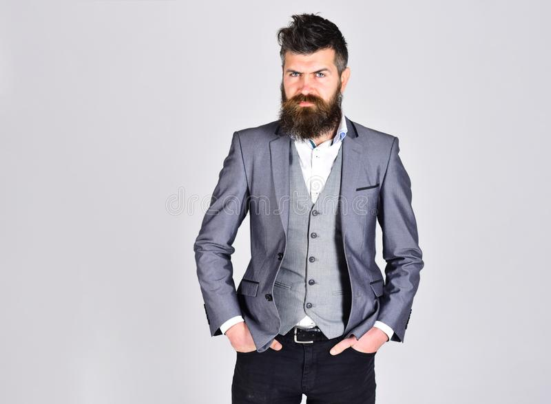 Bearded man in business suit on grey background, copy space. hipster has confindent look. beard care and barber royalty free stock photos