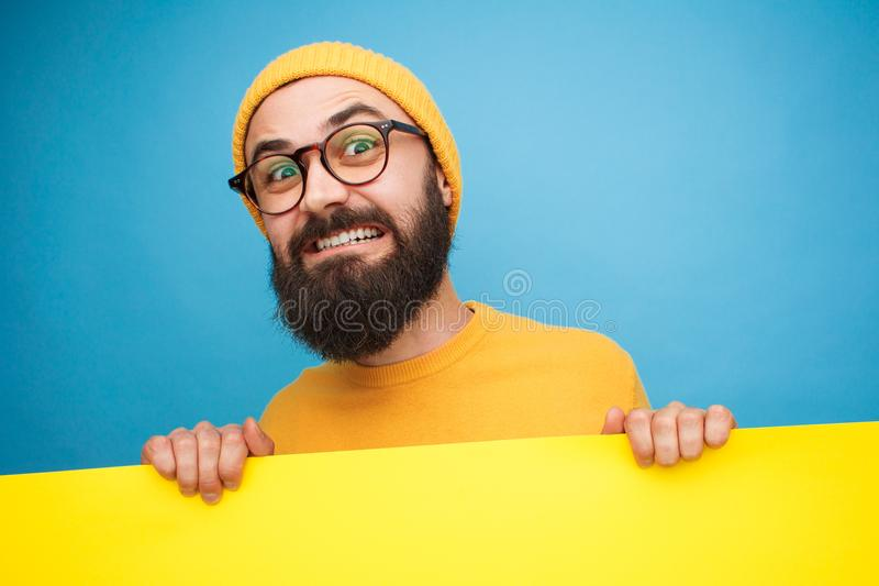 Bearded man carrying sign royalty free stock image