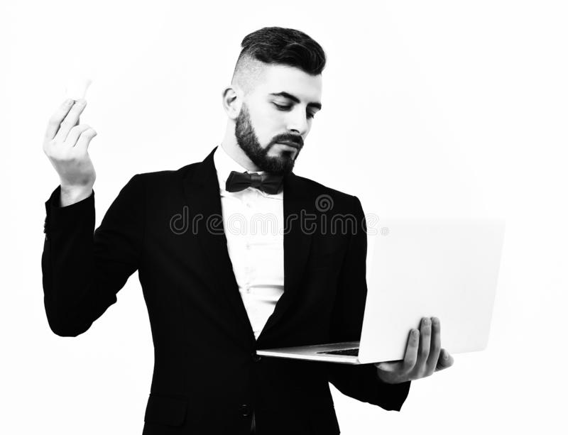 Bearded man in classic suit and bow holding light bulb stock photos