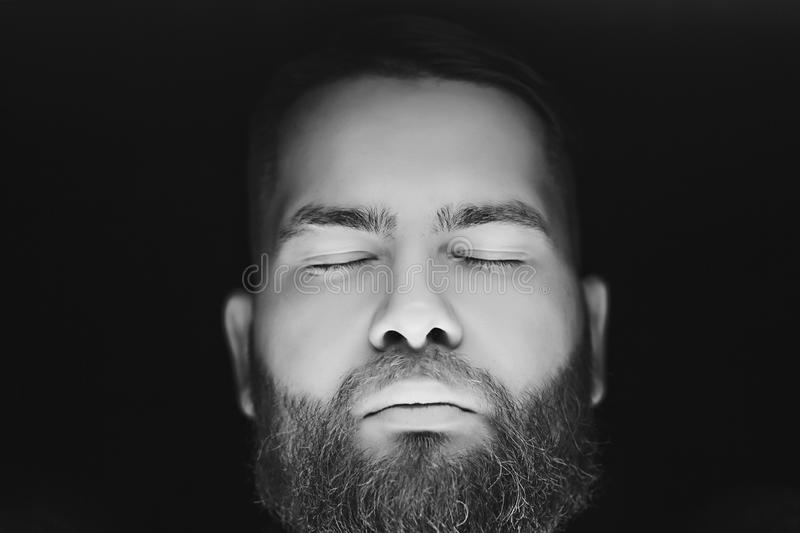Bearded man with closing eyes stock image