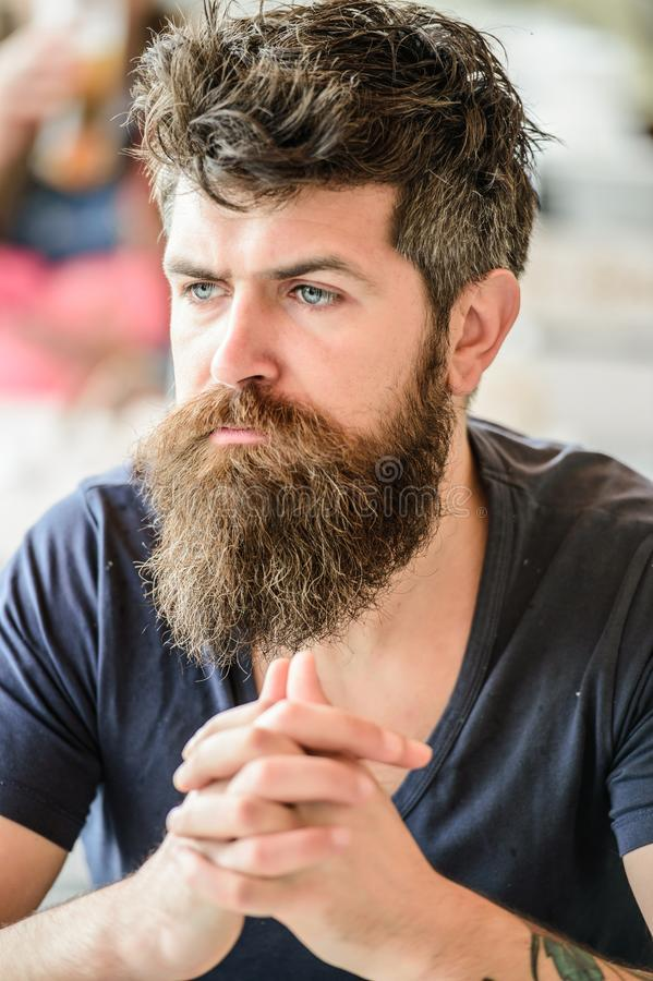 Bearded man concentrated face. Hipster with beard thoughtful expression. Thoughtful mood concept. Making important life. Choices. Making hard decision. Man with royalty free stock photo