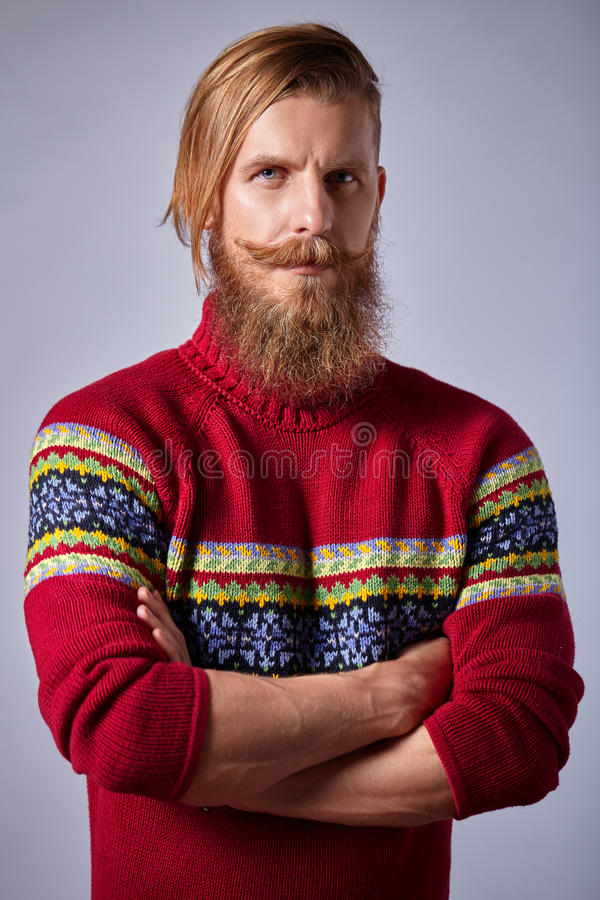 Bearded man with curled mustache knit red sweater standing royalty free stock image