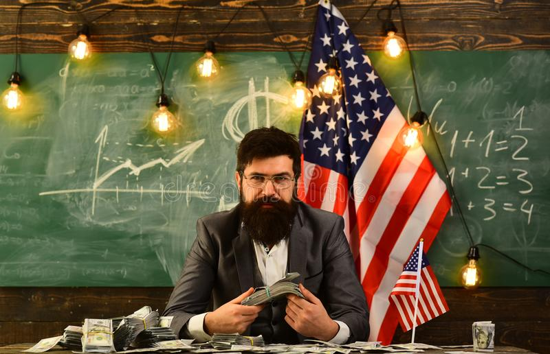 Bearded man with dollar money for bribe. American education reform at school in july 4. Independence day of usa. Economy. And finance. Patriotism and freedom stock photography