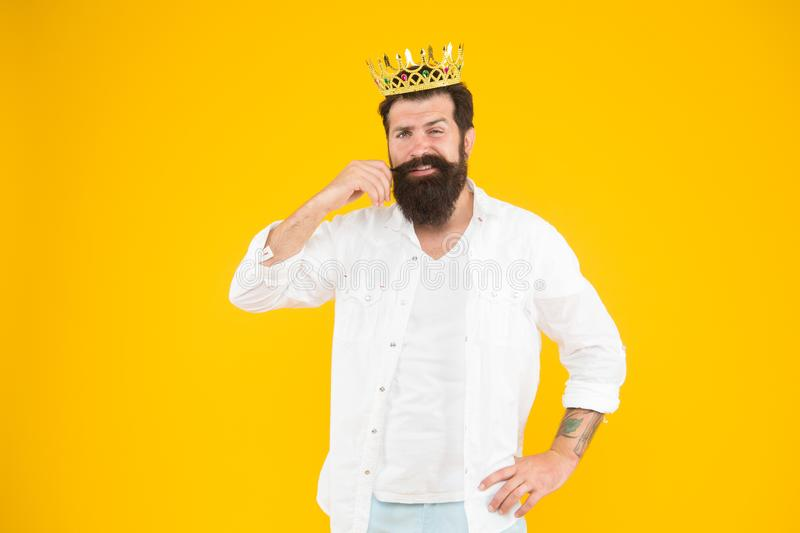 Bearded man dreaming. Love yourself. Holiday carnival celebration. brutal and handsome prince yellow background. King of. Party. Egoist selfish man royalty free stock photo