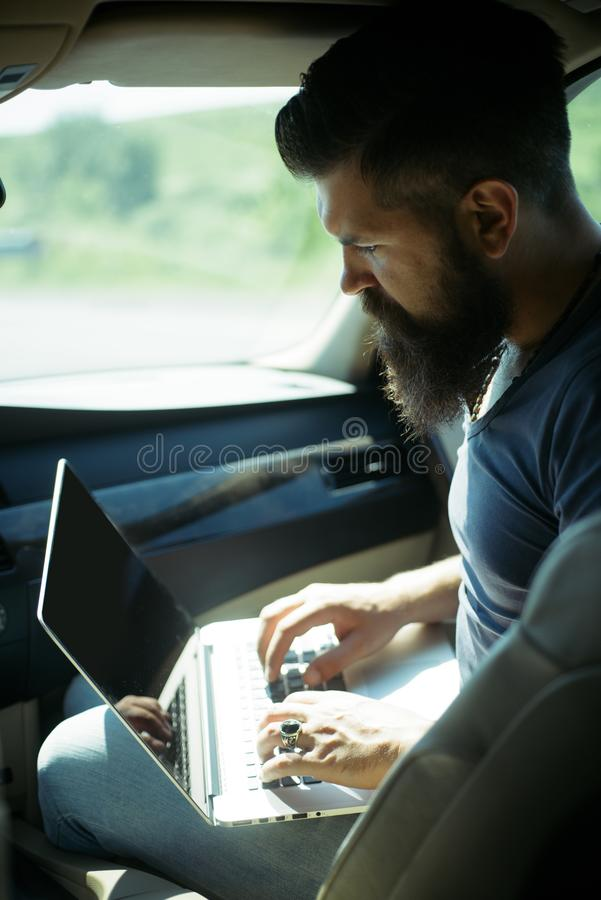Bearded man. earnings on Internet. job search. Mature hipster with beard. being late. rush hour. lack of time. deadline stock photos