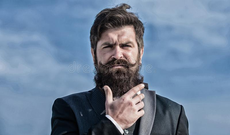 Bearded man. Future success. Male formal fashion. brutal caucasian hipster with moustache. Businessman against the sky stock photo