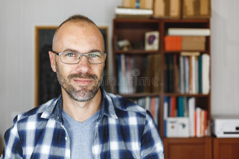 Smiling man in his office royalty free stock photography