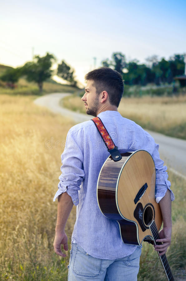 Bearded man with a guitar royalty free stock photography
