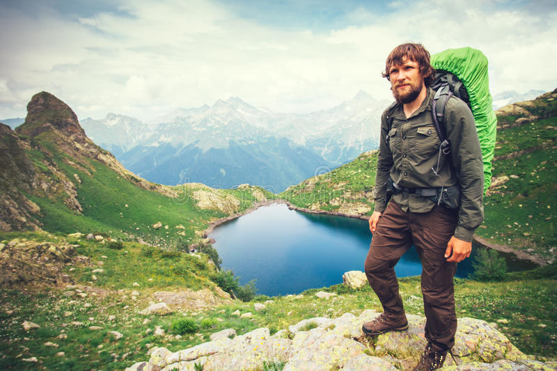 Bearded Man hiker with backpack mountaineering stock images