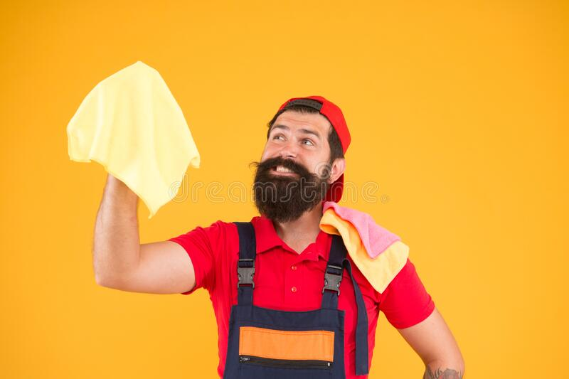 Bearded man hold duster microfiber for cleaning. man clean house. housekeeping business. call for cleaning service. male royalty free stock images