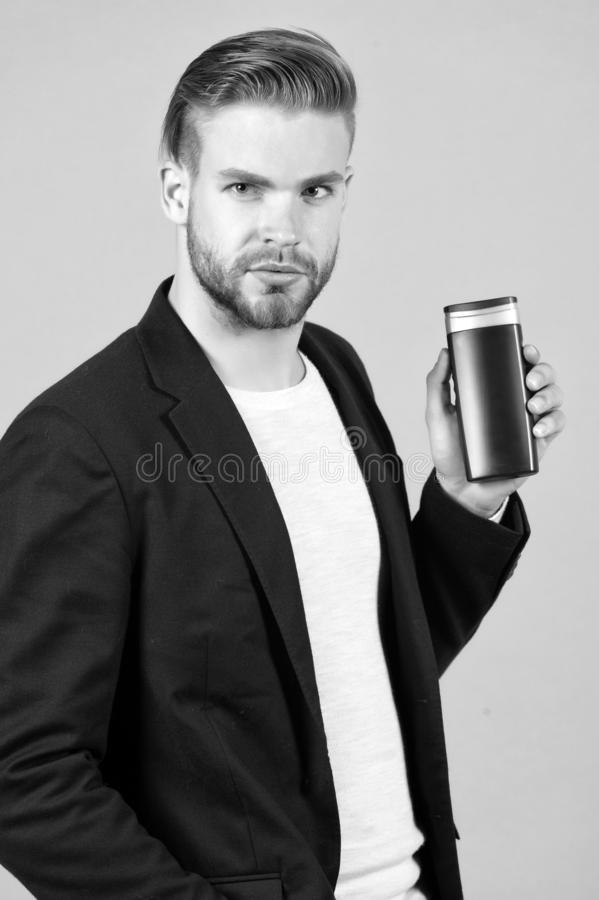 Bearded man hold gel tube. Businessman with shampoo bottle. Hair care and skincare. Health and healthcare. Morning. Grooming at hairdresser salon or barbershop royalty free stock image