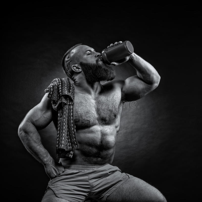 Bearded Man is holding a shaker for drinks stock image
