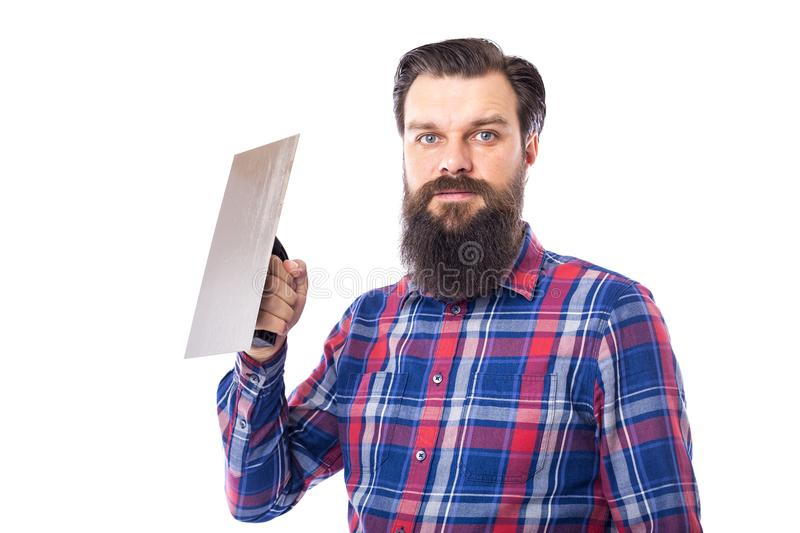 Bearded man holding used masonry tool isolated on white stock image