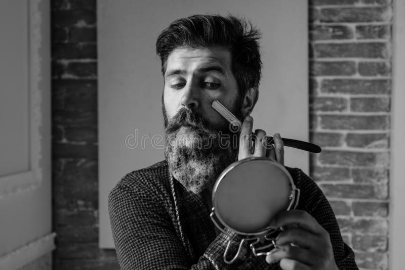 Bearded man - home beard style. Portrait of stylish man beard. Barber straight razor, barbershop. Vintage barber shop royalty free stock photo