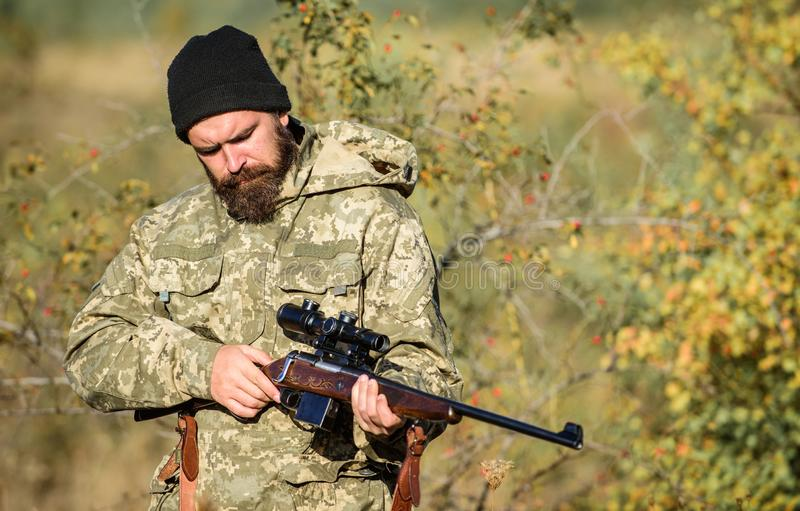 Bearded man hunter. Military uniform. Army forces. Camouflage. Hunting skills and weapon equipment. How turn hunting royalty free stock images
