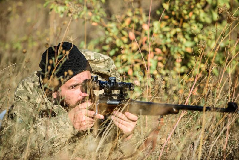 Bearded man hunter. Military uniform fashion. Army forces. Camouflage. Hunting skills and weapon equipment. How turn stock photography