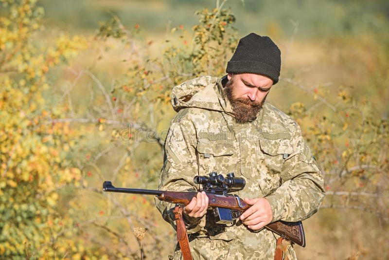 Bearded man hunter. Military uniform fashion. Army forces. Camouflage. Hunting skills and weapon equipment. How turn. Hunting into hobby. Man hunter with rifle royalty free stock photography