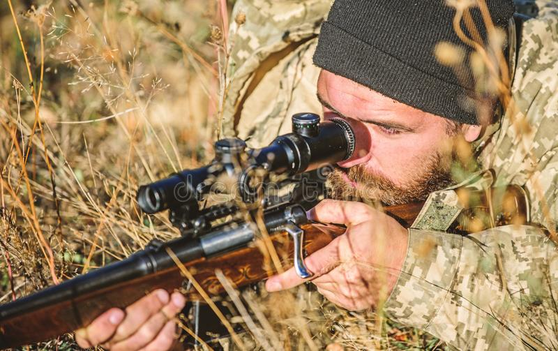 Bearded man hunter. Military uniform fashion. Army forces. Camouflage. Hunting skills and weapon equipment. How turn. Hunting into hobby. Man hunter with rifle stock photos