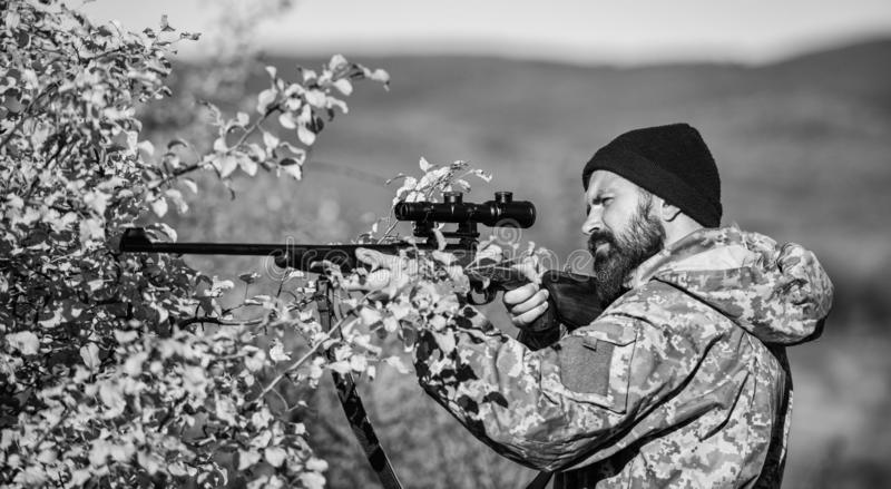 Bearded man hunter. Military uniform fashion. Army forces. Camouflage. Hunting skills and weapon equipment. How turn. Hunting into hobby. Man hunter with rifle stock images