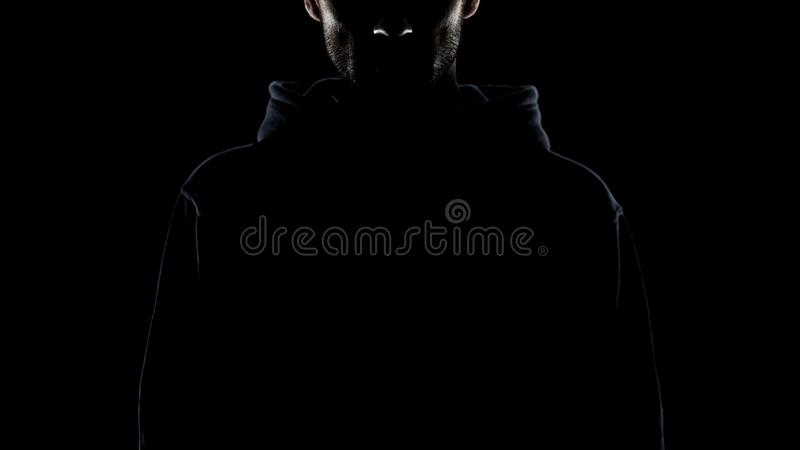 Bearded man invisible in night darkness, secret gangster, lawless intention royalty free stock photos