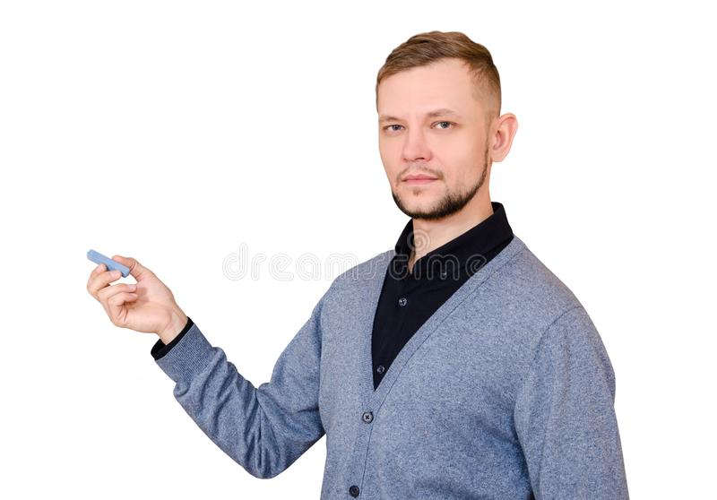 Bearded man in jacket and black shirt with blue chalk in his hand on white background stock images