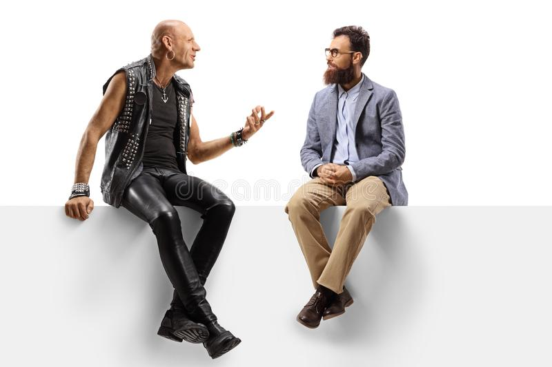 Bearded man listening to a punk talking on a panel. Full length shot of a bearded men listening to a punk talking on a panel isolated on white background stock photo