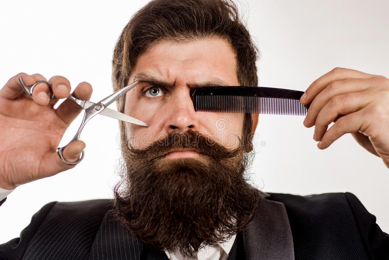 Bearded man with long moustache. Man in barbershop. Handsome bearded man with long beard moustache and brunette hair on stock photos