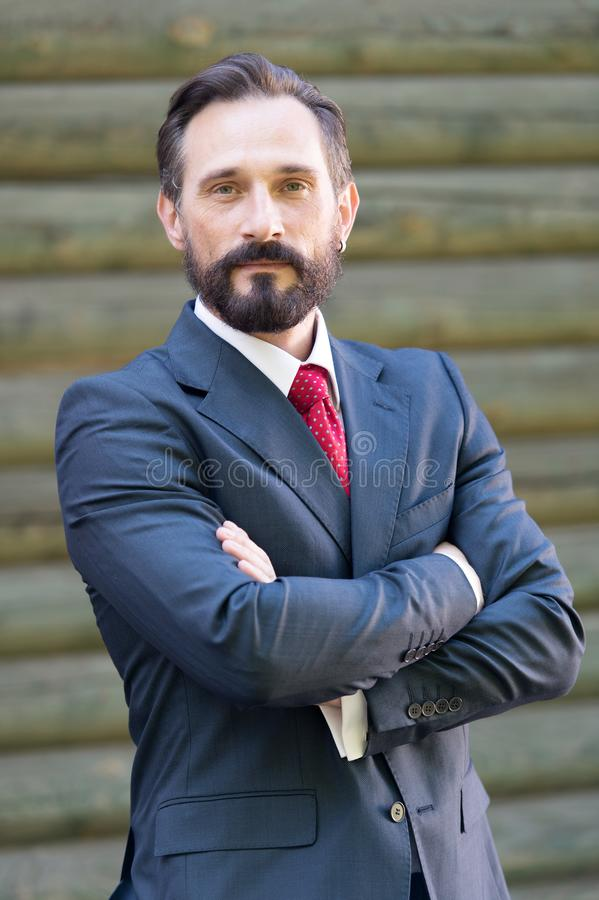 Bearded man looking calm while posing for laconic photo stock photos