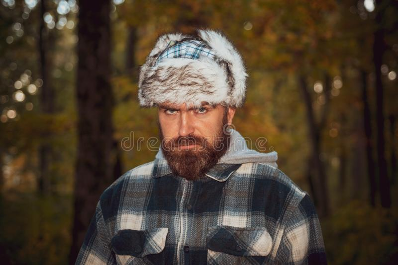 Bearded man looking on the camera, open-air shot. Old-fashioned clothing, retro style. Soviet collections. A serious. Look royalty free stock image