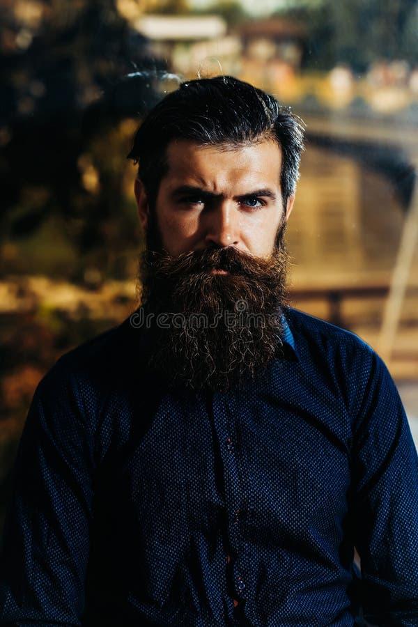 Bearded man with lush beard stock photos