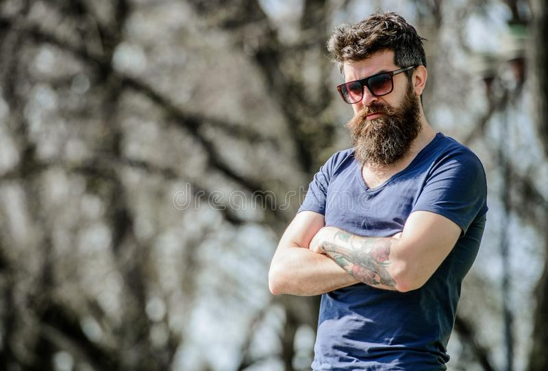 Bearded man with lush hair. Free and happy time. male fashion and beauty. Bearded man outdoor. Beard care and barbershop stock photo