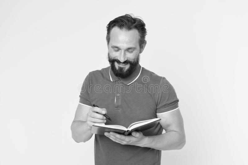Bearded man. Male barber care. brutal caucasian hipster with moustache. Mature hipster with beard. Waiting for new ideas. Happy man with notebook and pen stock image