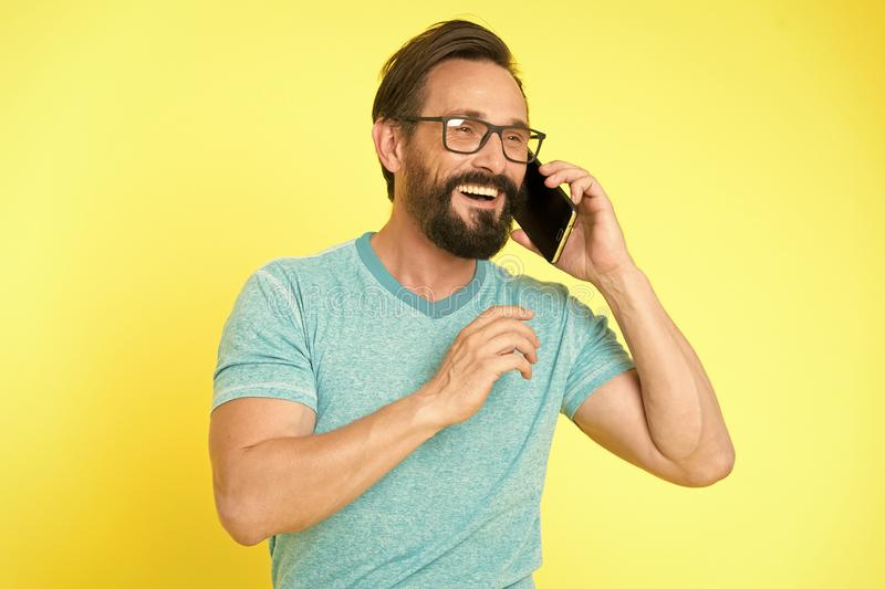 Bearded man. Mature hipster with beard. Facial care. Male fashion. brutal caucasian hipster with moustache. happy man. Speaking on phone. pleasant conversation stock photography