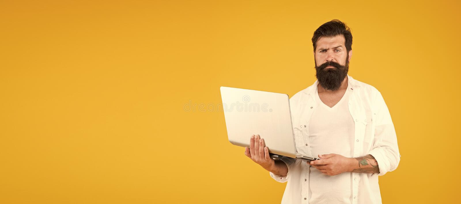 Bearded man with notebook. Online shopping. Man using notebook. Surfing internet. In search of inspiration. Online stock image