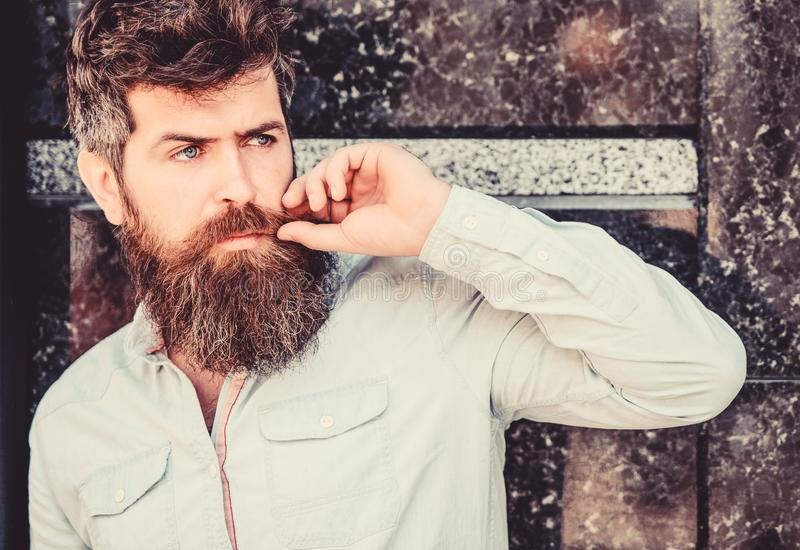 Bearded man outdoor. Beard care and barbershop. Mature hipster with beard. brutal male with perfect style. male fashion royalty free stock photos